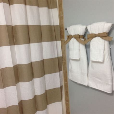 bathroom towel display ideas bathroom staging to sell your home neutral colors crisp white towels tied up with burlap bow