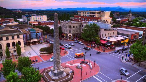 hire the granite goddess human statue in asheville