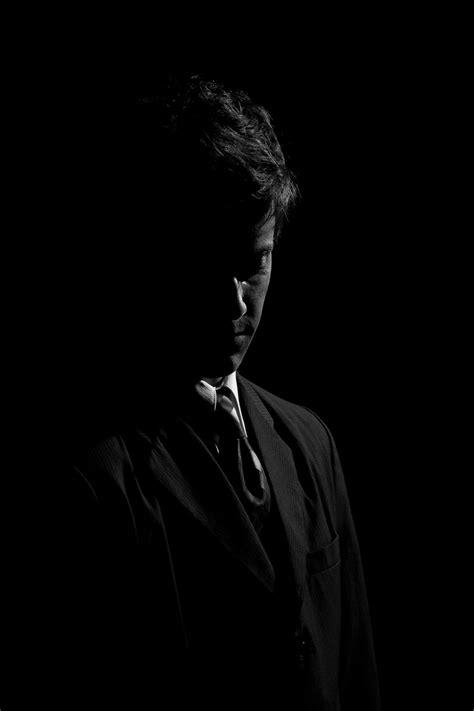 portrait rim light black  white suit woods