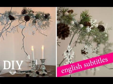 weihnachtsdeko basteln weihnachtlichen zweig dekorieren
