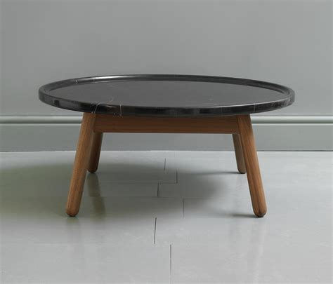 See the detailed images here. Carve marble round coffee table | Architonic