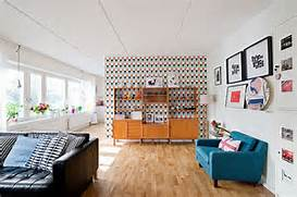 Modern Black House Bright Accents Bright Wallpaper Enlivens The Beautiful Living Room With Midcentury