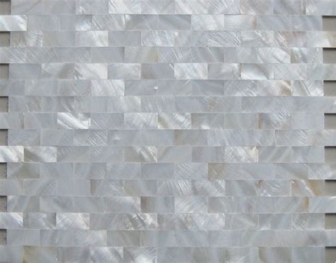 white mother of pearl tiles backsplash uniform bricks