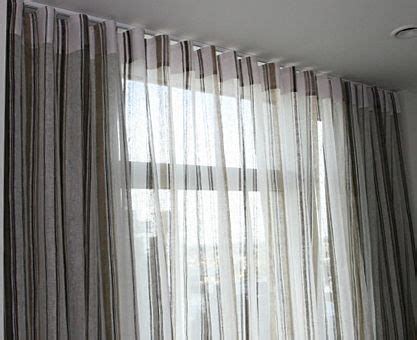 sheer curtain in the front and blackout drapery