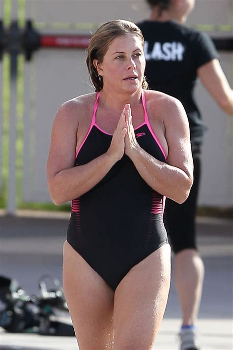 nicole eggert swimsuit nicole eggert in black swimsuit at pool on set of splash