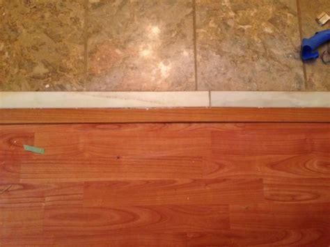 Laminate against tile when tile has transition already