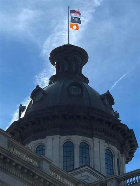 house with porch south carolina state capitol flying the clemson tiger flag