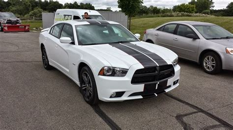 Bumper-to-bumper Gloss Black Racing Stripes Installed On A