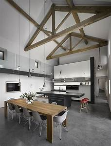 High ceilings with exposed wooden beams in renovated old