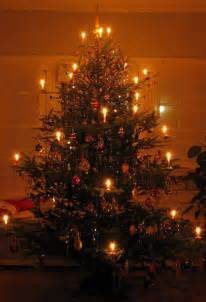 german christmas tree with lit candles germany austria alsace lorra