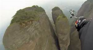 A Guy In A Wingsuit Flies Through A 30-Foot Wide Crack In ...