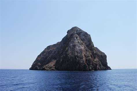 photo island rock cliff sheer face  image