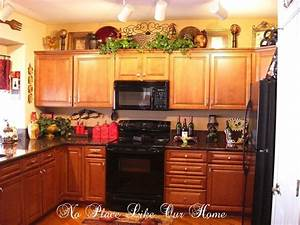 decorating ideas for top of kitchen cabinets home With kitchen cabinets lowes with large christmas canvas wall art