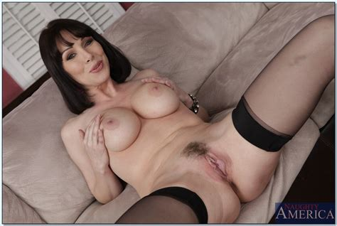 brunette milf stripping off her clothes and spreading her legs