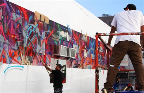 saber and zes collaborate in works new mural painted in