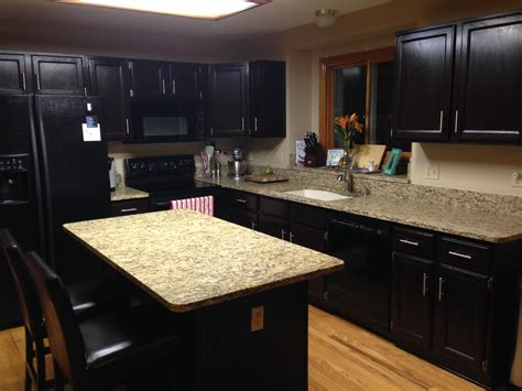 paint or stain oak kitchen cabinets gel stained cabinets goodbye honey oak gold confetti