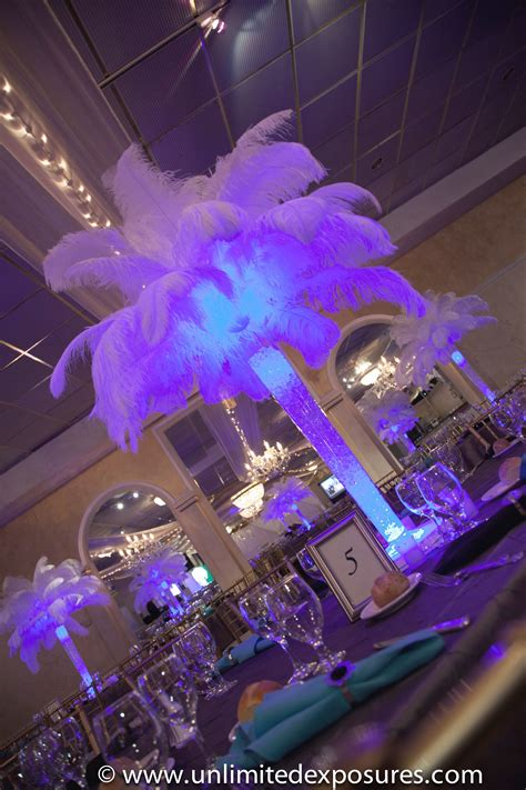 White Feather Centerpieces With Blue Uplighting Photo