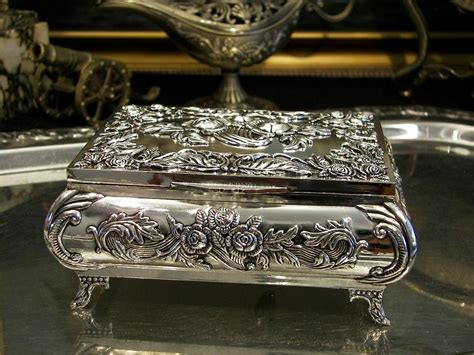 I do not know the name of the song that plays on them (it's the same song for both); Silver Plated Roses Jewellery Box Music Box For Necklaces Vintage Baroque | eBay