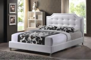the carlotta white modern bed with upholstered headboard