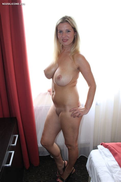 busty amateur wife near a big window