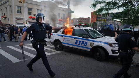 symbol  nyc unrest  burning police car