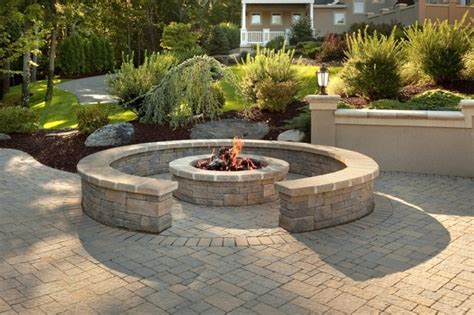 custom brick patio with pit and sitting wall