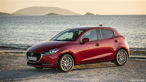 Soul of motion' design gives it standout presence to keep turning heads. 2020 Mazda2 (Color: Red Crystal) - Front Three-Quarter ...