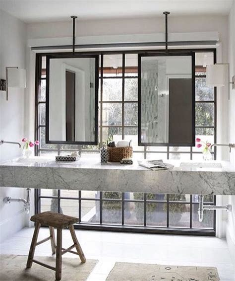 Hanging Mirror In Bathroom by Bathroom Ceiling Mounted Mirror In Front Of Windows