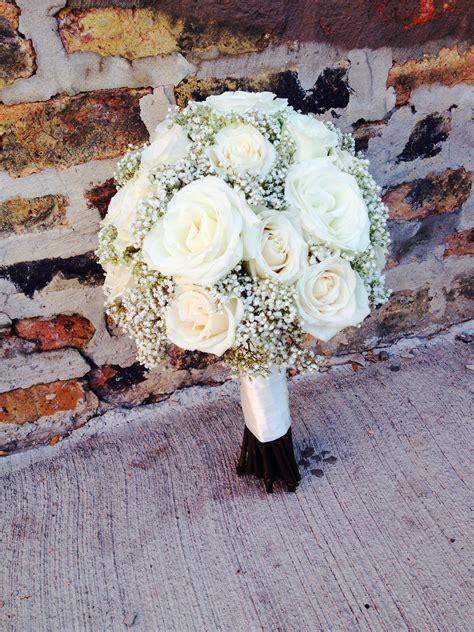 white roses  babys breath wedding bouquet