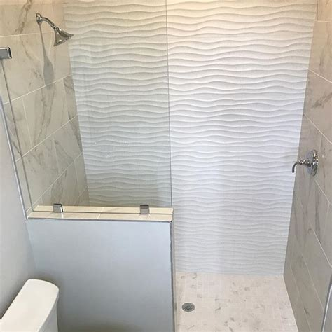 white wavy tile    fun summer inspired guest bath