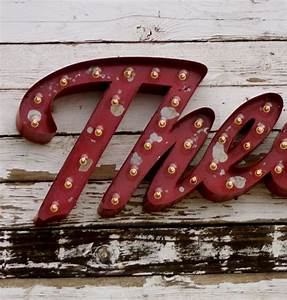 large cursive vintage style marquee letters metal steel With large vintage marquee letters