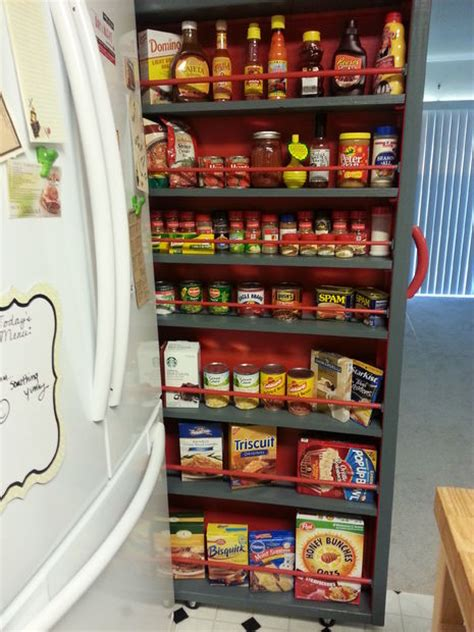 rolling spice rack empty space next to the fridge make a roll out pantry