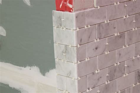 Tile Ideas For Kitchen Walls - tiling a bathroom shower with marble tile