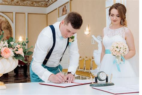 Beautiful Bride And Groom Signature In The Registry Office