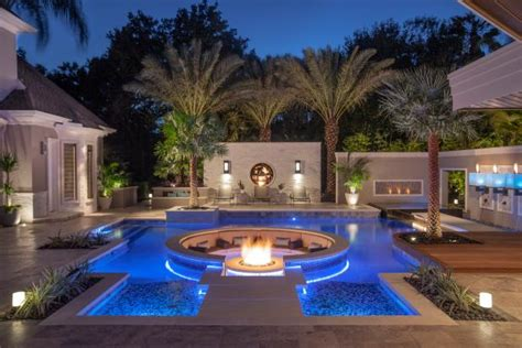 tropical pool  sunken fire pit seating area hgtv