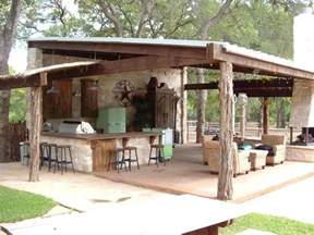 outdoor kitchen roof ideas ranch style entertaining a rustic covered outdoor kitchen in dallas goes big with a bar using
