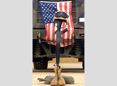 An M16a2 Service Rifle, A Pair Of Boots And A Helmet
