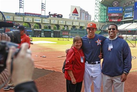 George Springer poses with his parents Laura Springer and