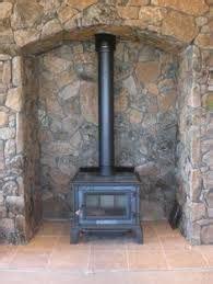 wood stove stone alcove house pinterest alcove