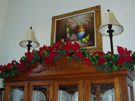 decorating  china cabinet   pine garland