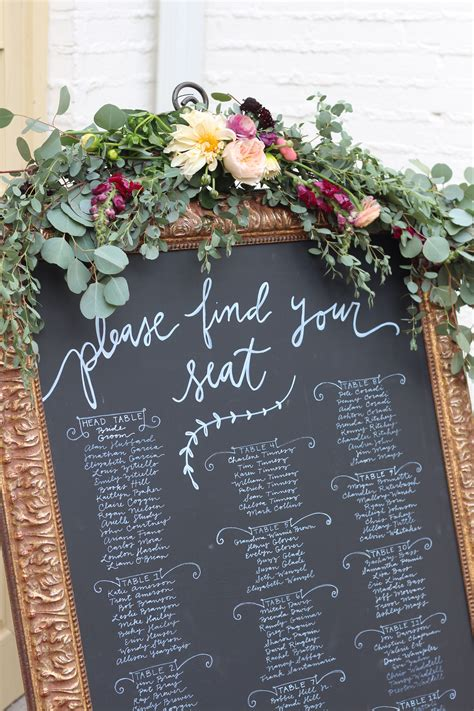 chalk board seating chart wedding flowers real