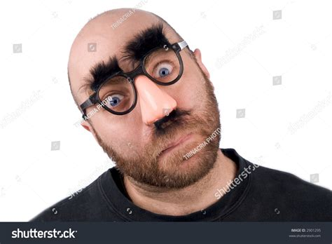 Man Wearing Fake Nose And Glasses With Mustashe And