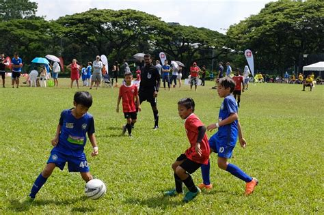 Develop boys and girls across all age groups and competitive levels to the best of their abilities; Football fun and life lessons at the Switzerland-Singapore Football Festival - ActiveSG