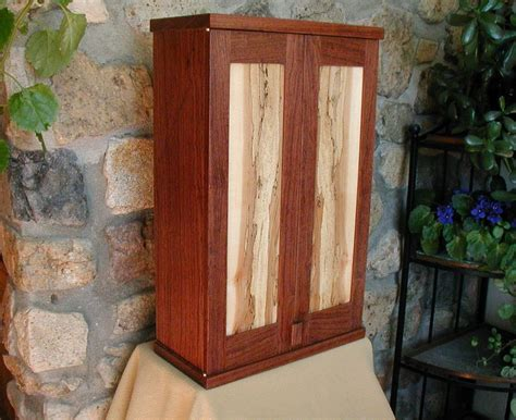 custom  bubinga  spalted maple wall cabinet  john