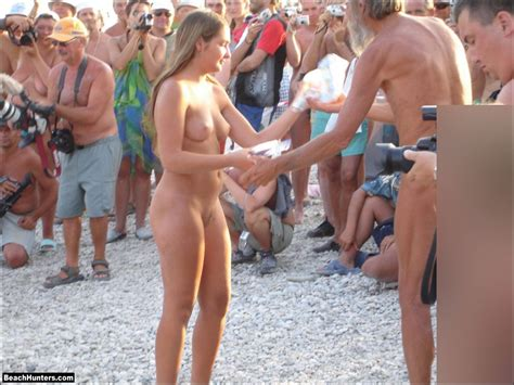 Nude In A Crowd On The Beach Nudeshots