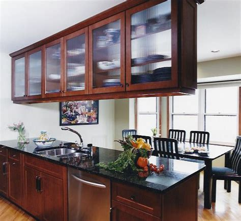 Glass Cupboards For Kitchens by Kitchen Peninsula With Glass Cabinet Doors