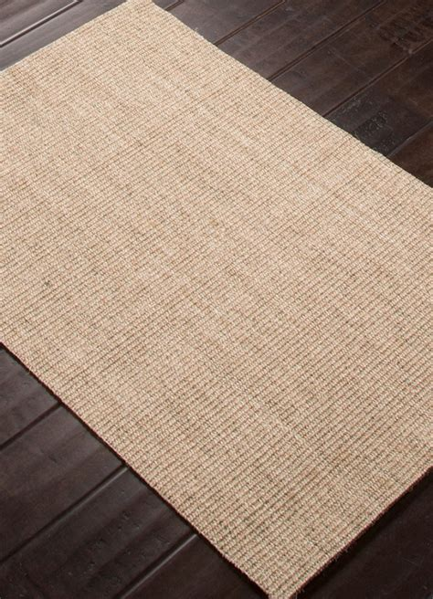 natural woven tight seagrass style rug sand