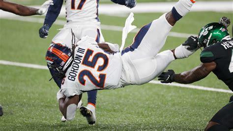 Denver Broncos running back Melvin Gordon goes over goal ...