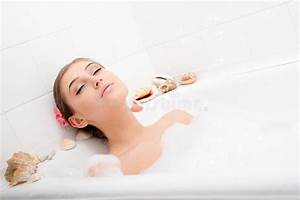 Relaxing Attractive Young Woman Lying In The Bath With