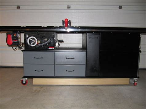 my sawstop and router cabinet with fold down outfeed table